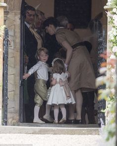 It seems that George was less than keen on attending the ceremony as he held back while his nannyMaria Borrallo ushered him into the chapel