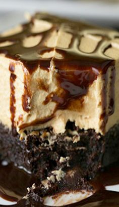 Peanut Butter Brownie Dream ~ A chocolatey chewy brownie base gets topped with a fluffy peanut butter layer, then drizzled with chocolate syrup right before serving to create this Peanut Butter Brownie Dream!