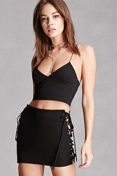 A stretch-knit mini skirt featuring lace-up self-tie side closures.<p>- This is an independent brand and not a Forever 21 branded item.</p>