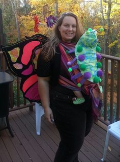 Beautiful babywearing costume: Jennifer is a mama butterfly with baby caterpillar!