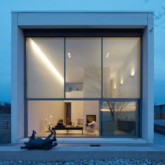 This house is situated on the coast of a Baltic island and features slanted roofs and walls that make the building narrower in the middle.