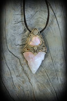 ~One of a kind clay pendant unique on it self!!! Pointy raw Rose Quartz is an amazing and magical gemstone. At the top i add a natural light milky