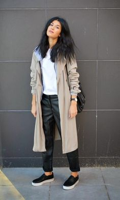Reach for a grey trench and black leather drawstring pants for a glam and trendy getup. Grab a pair of black leather slip-on sneakers for a more relaxed aesthetic.