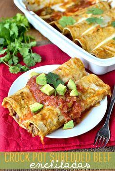 Crock Pot Shredded Beef Enchiladas.  Make sure you buy gluten free enchilada sauce