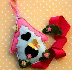 Whimsical Bird House Hair Bow Holder, with Butterflies, Felt bow holder, Storage, Organizer. $40.00, via Etsy.