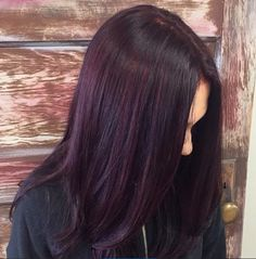 Beautiful plum color with red violet highlights by Victoria at Collage salon.