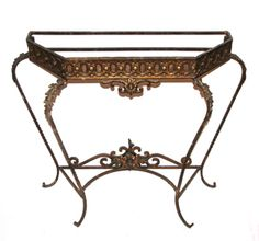 Material: wrought and cast iron  Location: MCT  Note: Vintage cast and wrought iron, bronze colored console table base.  Price: Call for Price  Quantity: 1  Status: avail  Price Type: single