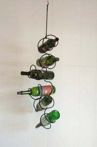 Climbing Tendrils Rack, 6 Bottle . $30.00. Made of wrought iron. Holds 6 wine bottles. Includes extender rod and eyehook. Three intertwining tendrils wrap around to hold six bottles. A great way to display wine, and a great conversation piece!