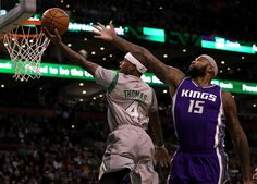 Boston, MA - 12/02/2016 - (1st quarter) Boston Celtics guard Isaiah Thomas (4) drives up and under the outstretched arms of Sacramento Kings center DeMarcus Cousins (15) for a first quarter layup. The Boston Celtics take on the Sacramento Kings at TD Garden. - (Barry Chin/Globe Staff), Section: Sports, Reporter: Adam Himmelsbach, Topic: 03Celtics-Kings, LOID: 8.3.852505292.