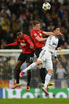 Real Madrid v Manchester United - Cristiano Ronaldo of Real and Danny Welbeck and Phil Jones of Manchester United.