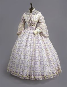Circa 1860 Day Dress of fine cotton printed with windowpane check and a floral pattern, pagoda sleeves with sheer engageantes.