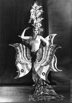 A cabaret dancer wearing a fantastic butterfly costume at the Folies Bergere theatre, Paris. (Photo by General Photographic Agency/Getty Images). Circa 1910