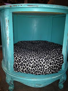 Thrift Store end table turned into a pet bed. I would love to do this for my dog, the only thing is that she might not fit ;-)