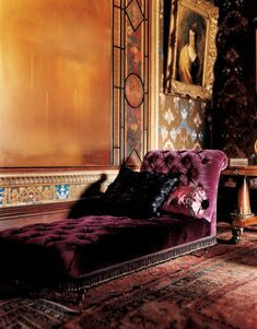 Plum velvet fainting couch.