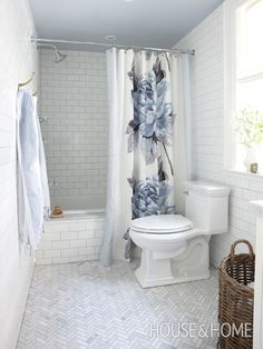 The layout of this bathroom was opened up by repositioning the tub.   The tub was repositioned along the back wall and faced with subway til...