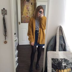 ✭○yellow button-up cardigan, striped shirt, button-up jean skirt, black tights, low black doc martens○✭