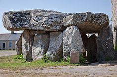 France. Crucuno dolmen in Plouharnel, Brittany, France :: Dolmen: portal tomb, portal grave: Type of single-chamber megalithic tomb, usually consisting of 2 or more upright stones supporting a large flat horizontal capstone (table), though there are more complex variants. Most date from the early Neolithic period: 4000 to 3000 BC.