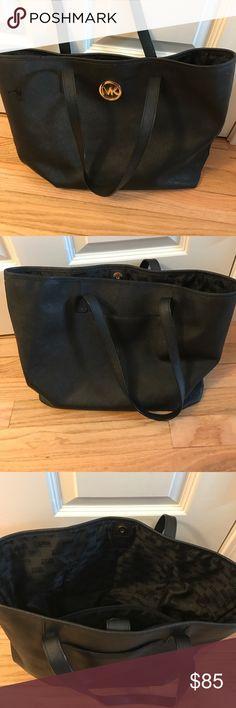 "Michael Kors handbag MK large tote black. Used, no stains or tarnishing. 3 pockets inside/ 1 outside. About 11""h x 15""w MICHAEL Michael Kors Bags Totes"