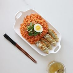 quick-cooking noodles, typically served in a broth with meat and vegetables.