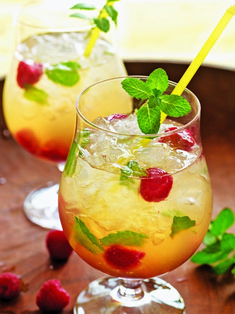 The Bruja Smash Ingredients      Crushed ice     7 fresh mint leaces     7 fresh raspberries     1½ ounces white tequila     1 ounce Strega     ½ ounce freshly squeezed lemon juice     1 mint sprig, for garnish