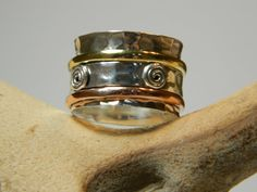 Spinner rings with copper brass and silver bands by PureSterling, $42.00