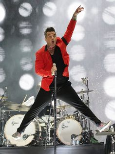 Robbie was literally jumping for joy during his set. Robbie Williams Lyrics, Robbie Williams Take That, Lou Williams, Gary Barlow, Jumping For Joy, Famous Singers, Most Handsome Men, Concert, A Good Man