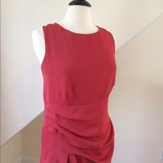 "NWT Anne Klein Coral Dress NWT Anne Klein Coral Dress...sleeveless, high-round neckline (sits at collar bone)....princess seams shape back of dress...softly draped fabric over loose pleats adds lovely detail...back zipper with hook/eye closure...modesty tabs keep bra straps in place (genius!)...dry clean only...length 38"". Retail $139 Anne Klein Dresses Midi"