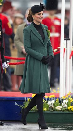 Kate Middleton showed off her pregnancy bump in a rich green Emilia Wickstead coat at the St Patrick's Day Parade.   - TownandCountryMag.com