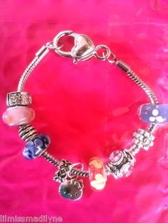 $15.00 Buy it Now Hello Kitty Pretty Handmade Silver Charm Bracelet w/ 9 beautiful bead charms NEW
