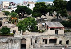 *HERCULANEUM, ITALY ~ The view out over the archaeological site at Herculaneum, w/the modern suburbs of Ercolano in the background.
