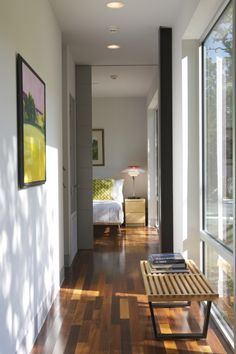 Oh, this is lovely! The big pocket door, that floor, those windows, I like!