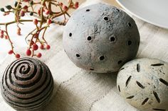 """""""House of Ceramics"""" on etsy ... Group of three textured ceramic spheres in pale red, blue gray and yellow. 3"""