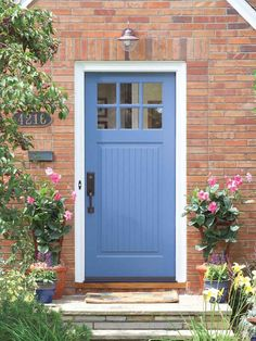 A fresh coat of colorful paint and updated hardware on your front door give your home a quick face-lift.