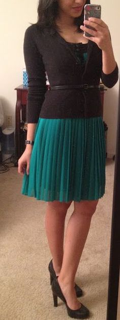 Work and office attire. Green/teal dress with black sweater and heels. thin black belt