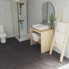 Bathroom outline - tiling on sides and wooden modern vanity with plant