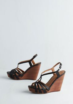 Brunette Wedge in Black. Though the average fashionista is sure to adore these stacked wedges by Seychelles, the pair itself is anything but! #black #modcloth