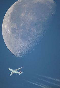 747 cruising past the moon..what a shot!