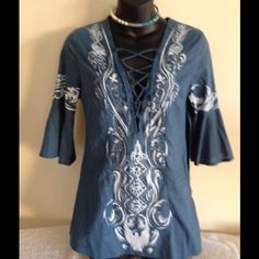 """NWT FARINELLI BLUE CUTE TOP SIZE SMALL NWT Farinelli size small cute blue blouse.    Shoulder to hem 25"""", 14-3/4"""" shoulder to sleeve hem, 10"""" left side zipper (see picture) and 2-1/2"""" side lit on each site.  Armpit to armpit 17"""".  100% cotton.  Front has embroidered areas top to bottom. Farinellii Tops Blouses"""