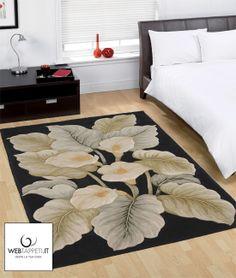Tappeto nero con foglie e fiori