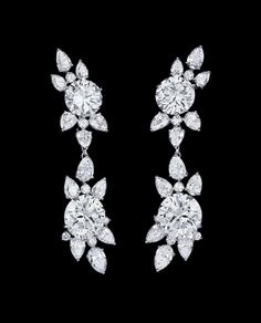 """Alexandre Reza """"Twin"""" Earrings featuring brilliant-cut diamonds weighing 3.59cts (G. IF), 3.42cts (G. IF), 5.63cts (H. VVS2), 6.04cts (G. IF), pear-shaped diamonds and brillant-cut diamonds weighing 10.48cts."""