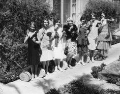 Models demonstrate face powder circa 1930