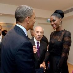 President Obama meets Miss Israel, Yityish Aynah,  during his trip to Israel at a State Dinner hosted by Israel's President Shimon Peres's home in Jerusalem. She is historic in Israel. She is the FIRST Black woman (and woman of color) to be crowned Miss Israel (their Miss USA) who will go on to compete in the Miss Universe contest. First Black President meets First Black Miss Israel.