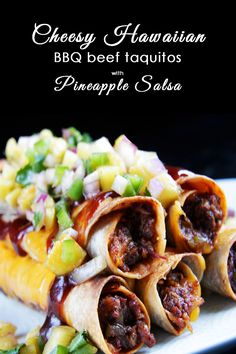 FAMILY FAVORITE!!!   BAKED! Cheesy Hawaiian BBQ Beef Taquitos & Pineapple Salsa - Beef smothered in spicy, sweet, smoky barbecue sauce, mixed with cheddar cheese, then rolled in a tortilla and broiled to crispy perfection then topped with pineapple salsa. AMAZING!   | Carlsbad Cravings