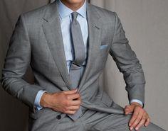 light grey suit with blue details