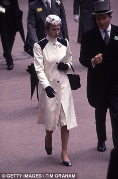 Princess Anne first sported the military-style cream coat with cap and bag, shoes and gloves in 1980