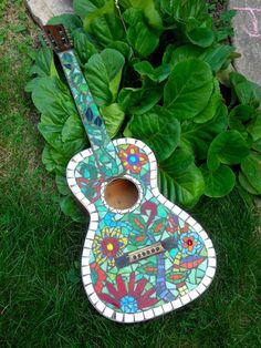 Garden Guitar. I have a play one that the kids got somewhere, which is broken. Now I Know what I can do with it.
