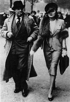 Marlene Dietrich and his husband Rudi walking down the street in Paris, 1930's