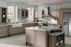 Taupe kitchen cabinets and white countertops #kitchendesign #kitchenideas