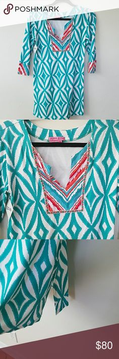 JOYOUS & FREE Tunic NWOT beading around small v neck. 3/4 sleeves. Turquoise & orange. Slits 6inches up sides. Absolute head turner! Great as bathingsuit cover up with heels. Indah Dresses Mini