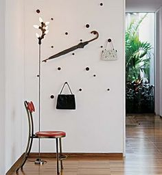 Love the floating effect, and the use of the wall for artful display of essentials with a practical purpose.